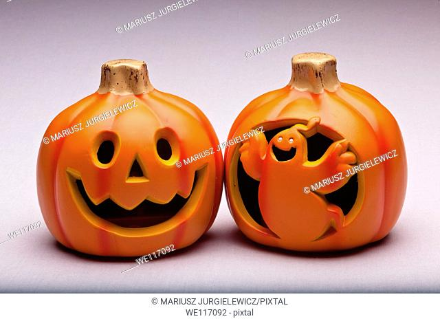 Plastic Halloween Jack o' Lantern decoration imitating curved pumpkin