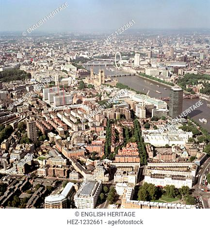 Aerial view of Westminster, London, 2002.This view shows how closely many of London's landmarks are clustered. In the middle distance are the Houses of...