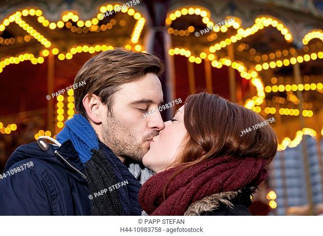 couple kissing on christmas marekt