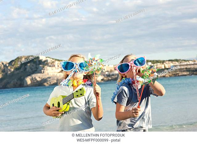 Spain, Mallorca, Children playing on beach