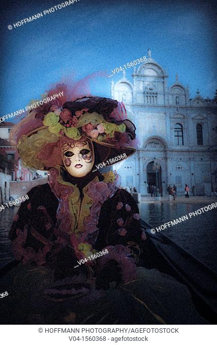 A mystical view of a masked woman in a gondola at the carnival in Venice, Italy, Europe