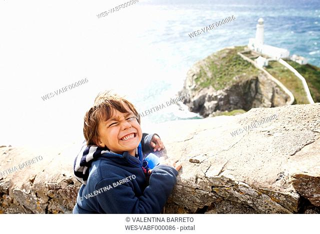 UK, Anglesey, portrait of little boy pouting mouth