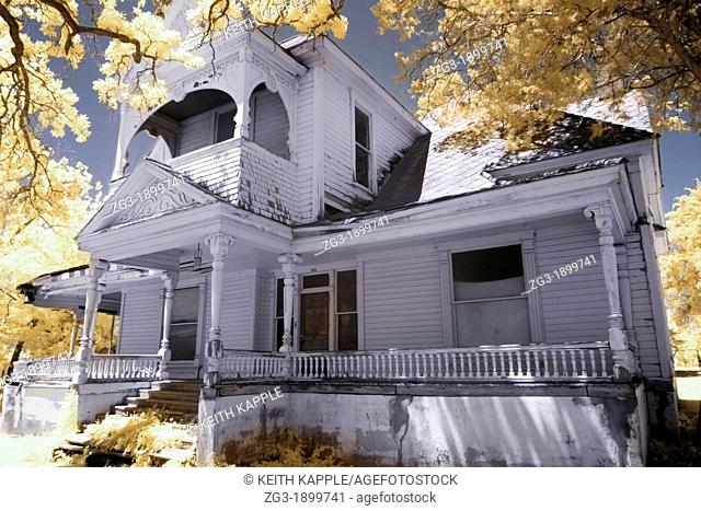 Infrared photography of the Exterior view of a Victorian era home, 1887, Calvert, Texas