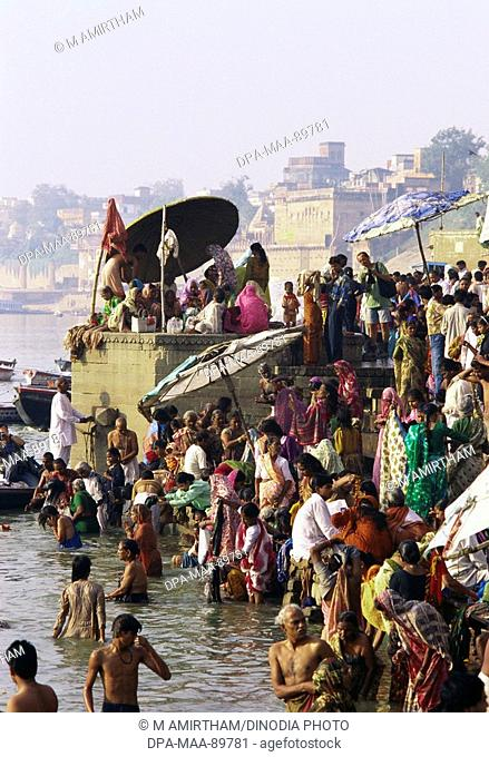 People bathing in River Ganga at Sunrise , Varanasi , Uttar Pradesh , India