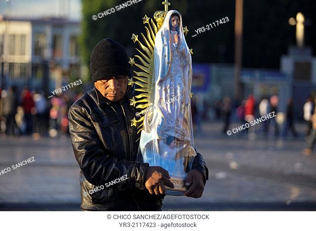 A pilgrim holds an image of the Virgin of Guadalupe at the pilgrimage to Our Lady of Guadalupe Basilica in Mexico City, Mexico, December 10, 2013