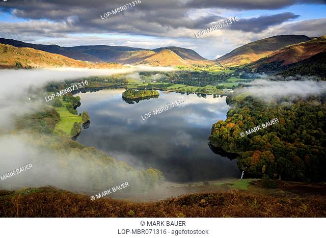 England, Cumbria, Keswick. Mist clearing over Grasmere viewed from Loughrigg Hill