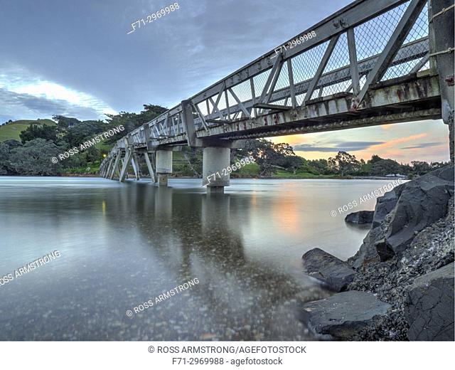 Foot bridge connecting Pataua South and Pataua North at sunset. Northland, New Zealand