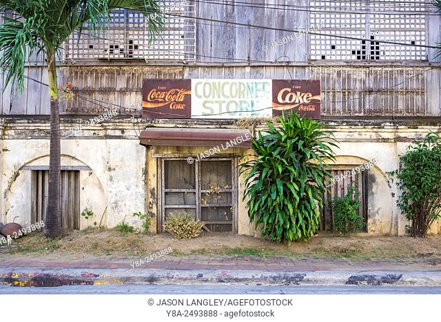 Faded Coca-Cola sign on a corner store, Vigan City, Ilocos Sur, Ilocos Region, Philippines