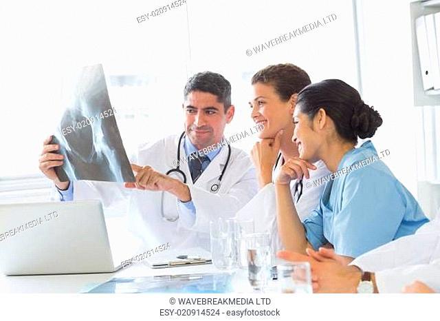Smiling medical team analyzing xray