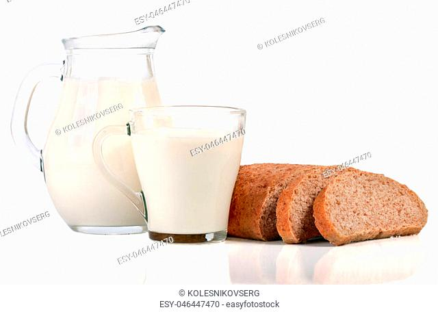 jug of milk with a loaf of bread isolated on white background