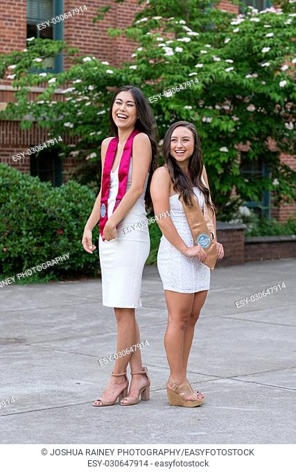 EUGENE, OR - MAY 22, 2017: Best friends and sorotrity sisters pose together for a graduation photo on campus at the University of Oregon in Eugene