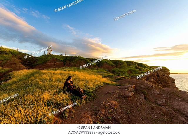 woman, sunset, cell phone, taking picture, Cape Tryon, Prince Edward Island, Canada, ocean