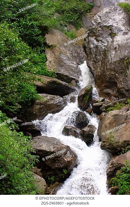 A rocky mountain waterfall. Himachal Pradesh, India