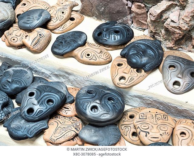 Pottery in the canyon Quebrada de Humahuaca, masks in inca syle. The Quebrada is listed as UNESCO world heritage site. South America, Argentina, November