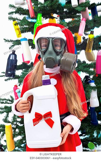 Young girl with her plastic christmas present - environmental concept, isolated