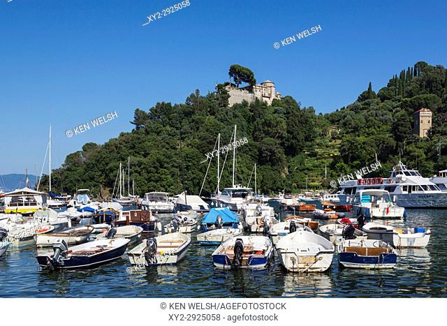 Portofino, Genoa Province, Italian Riviera, Italy. View across the harbour to Castello Brown