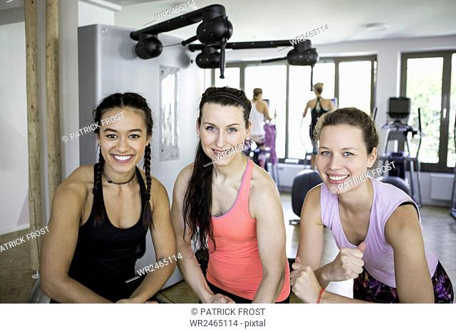 Portrait of three girlfriends in health club