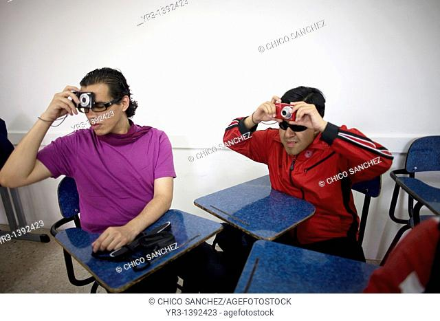 Blind and visually impaired students take a picture