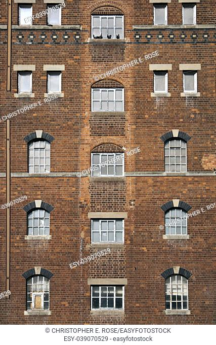Brick wall and windows pattern on a disused industrial building in Tewkesbury, Gloucestershire, UK
