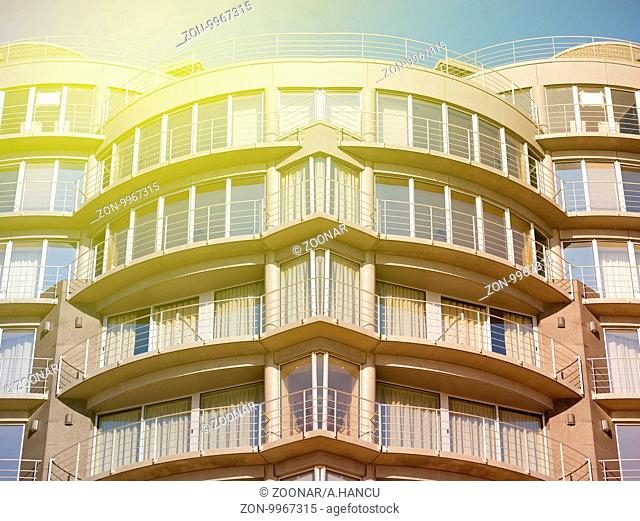Modern, large apartment building on sunny day