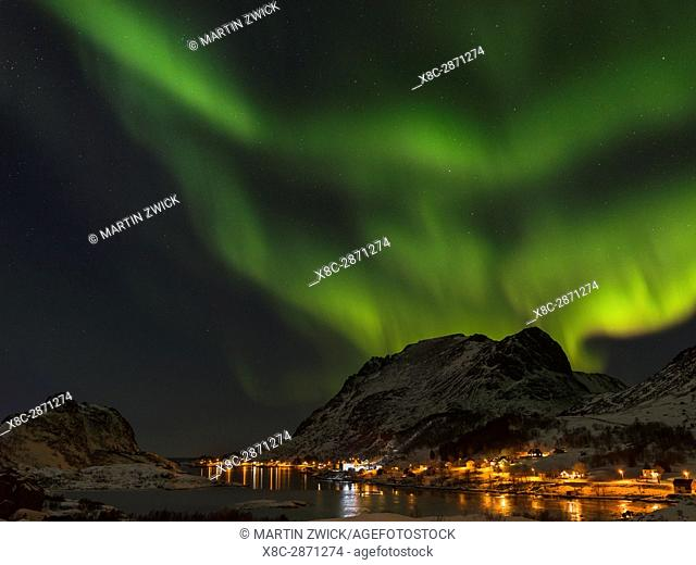 Northern Lights over fjord Maervollspollen and village Maervoll, island Vestvagoy. The Lofoten islands in northern Norway during winter