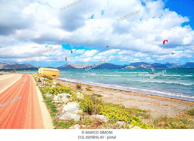 Kitesurfing on beach, Alcudia, Majorca, Balearic Islands, Spain, Europe