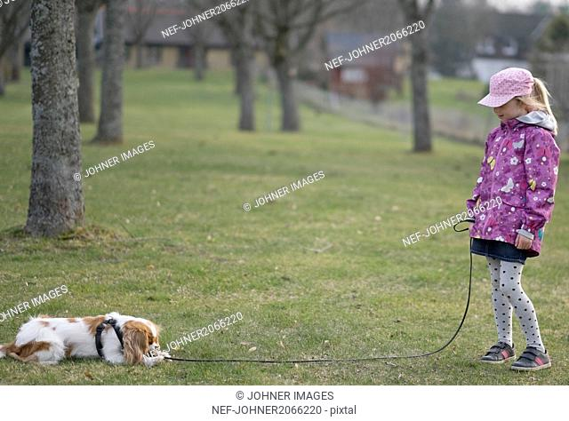 Girl with dog on walk