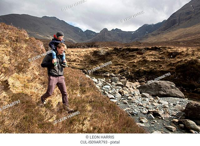 Father and son hiking, Fairy Pools, Isle of Skye, Hebrides, Scotland