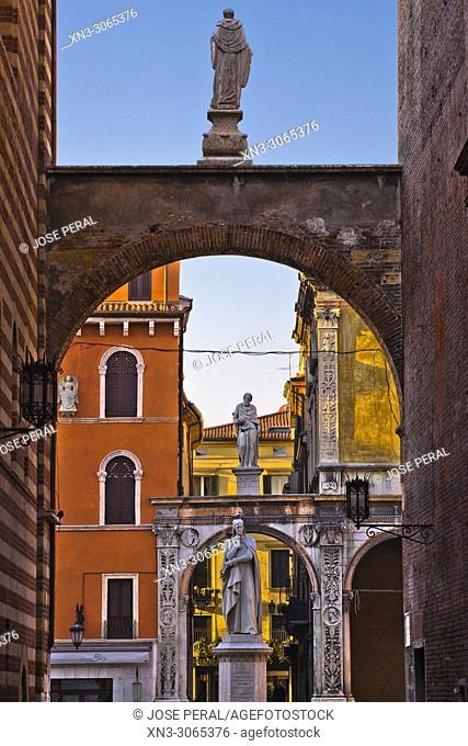 Statue of Dante Alighieri, on background Girolamo Fracastoro's statue, at left Casa della Pietà house, Piazza dei Signori square, Verona, Veneto, Italy, Europe