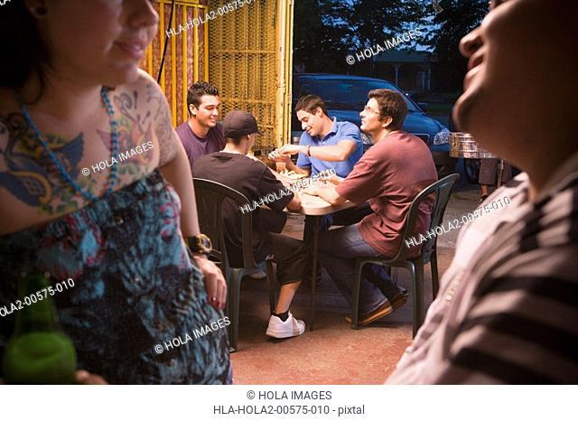 Couple talking at local bar