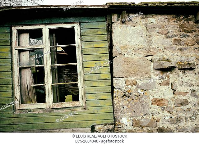 Window in an abandoned green wood house in Yorkshire Dales, England, UK, Europe