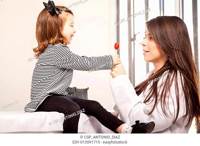 Little girl getting a lollipop