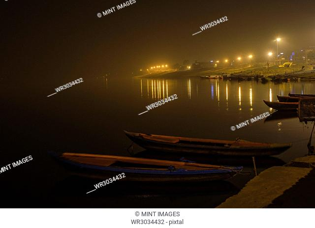 Boats moored at night on the Ganges at Varanasi, India