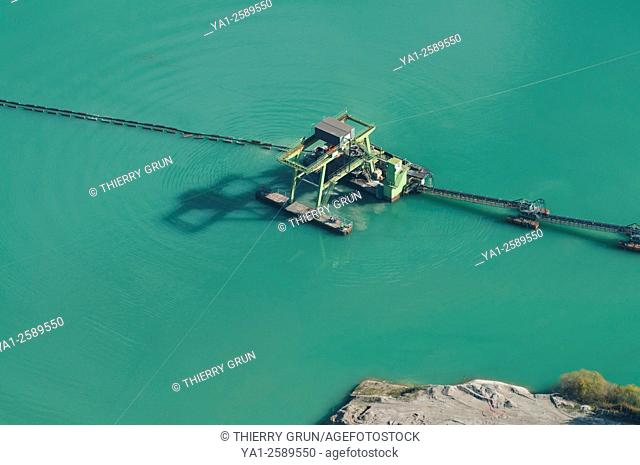 France, Bas Rhin 67, Gambsheim, floating pump on lake to extract gravel and sand aerial view