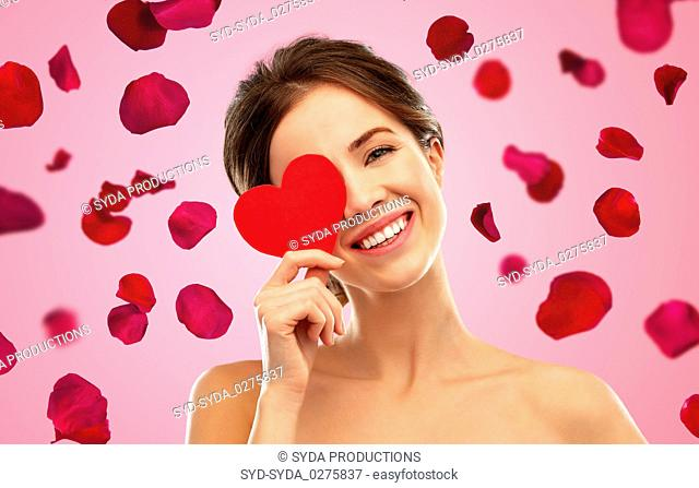 beautiful smiling woman holding red heart