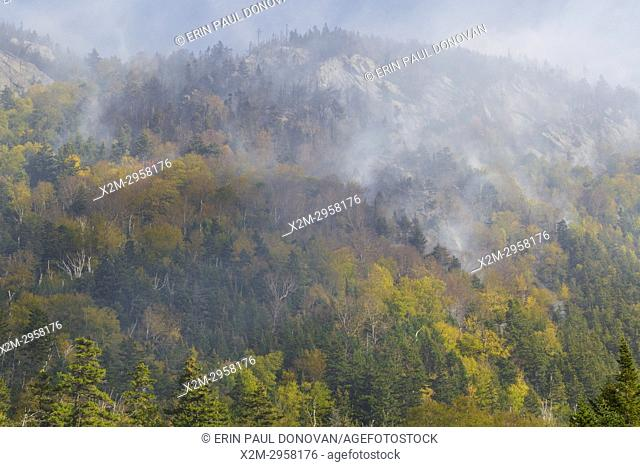 Smoke from a forest fire on Dilly Cliff in Kinsman Notch New Hampshire in October 2017. These cliffs are located behind the Lost River Gorge and Boulder Caves...