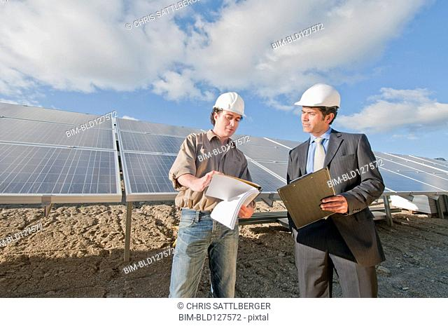 engineer and businessman in solar plant