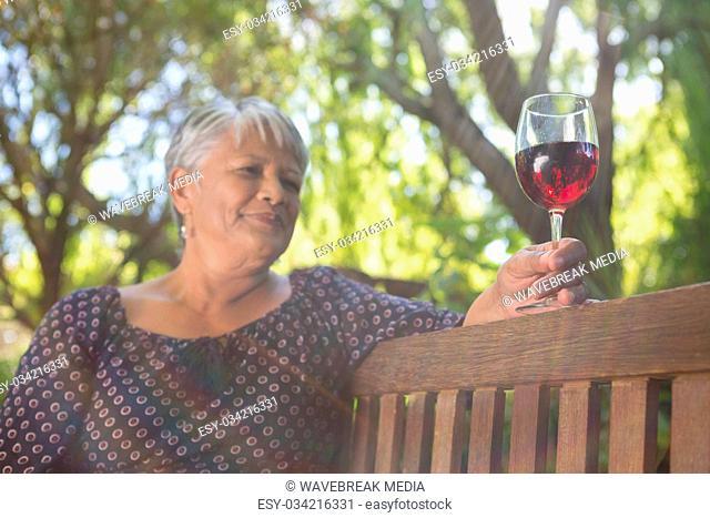 Senior woman holding wine glass