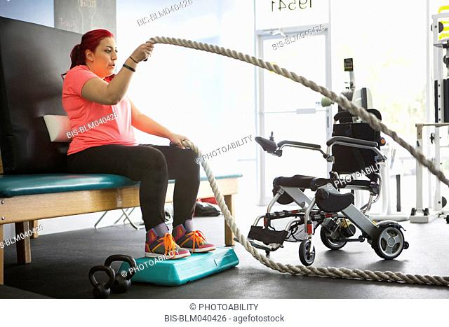 Disabled woman doing physical therapy in gym