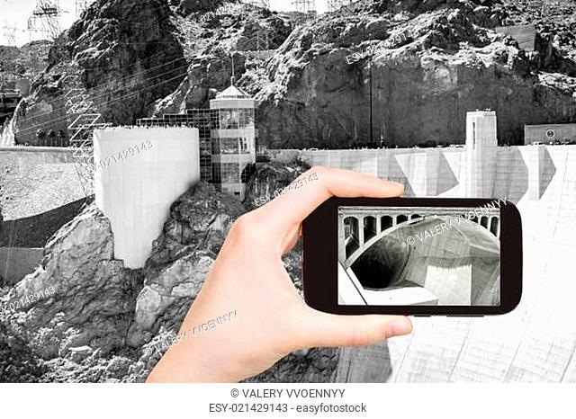 tourist shooting photo of Hoover Dam
