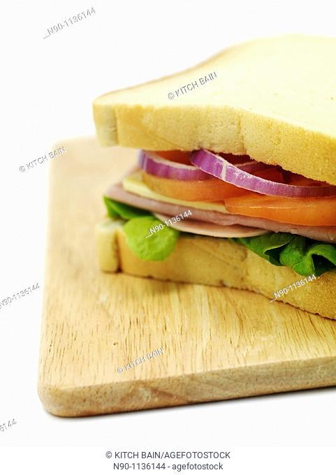 A freshly made ham sandwich on a kitchen bench