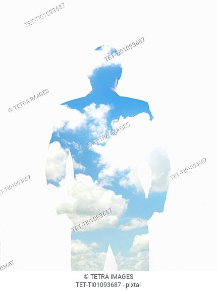 Composite image of clouds and silhouette of man