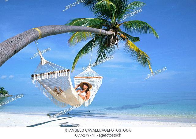 Woman on a hammock. Ari Atoll, Maldives