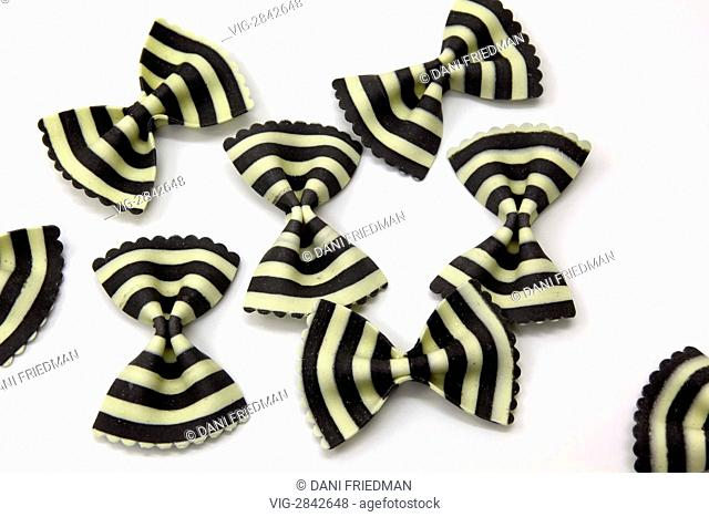 Black and white striped farfalle (bowtie) pasta. The distinct black stripe colour of the pasta is derived from squid ink which is a known Italian delicacy
