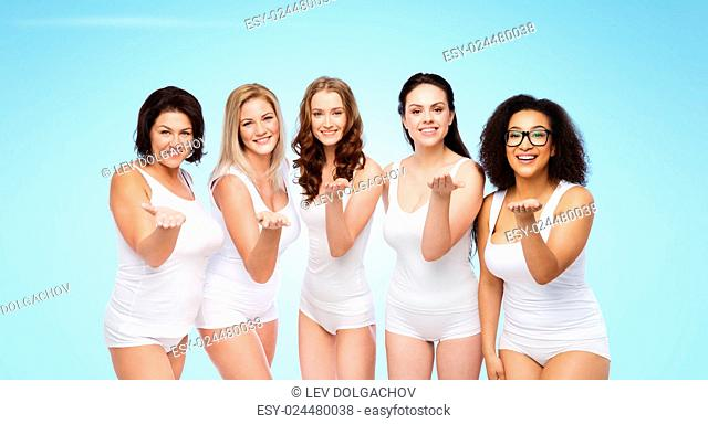 love, friendship, beauty, body positive and people concept - group of happy plus size women in white underwear sending blow kiss over blue background