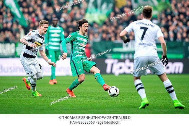 Moenchengladbach's Andre Hahn (L) plays against Bremen's Thomas Delaney (R) during the German Bundesliga soccer match between SV Werder Bremen and Borussia...