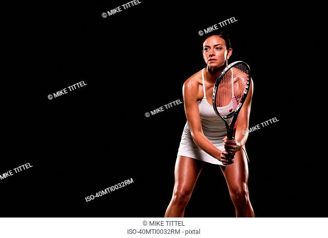 Woman playing tennis indoors