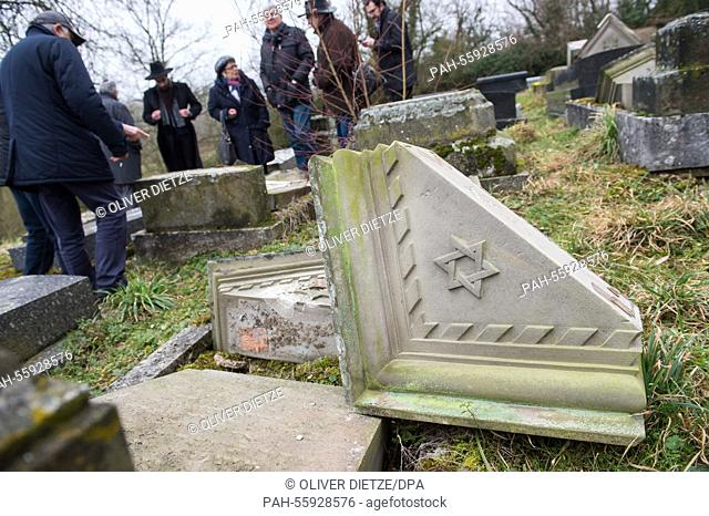 After a commemoration at a Jewish cemetery people are allowed to return to the graves in Sarre-Union, France, 17 February 2015