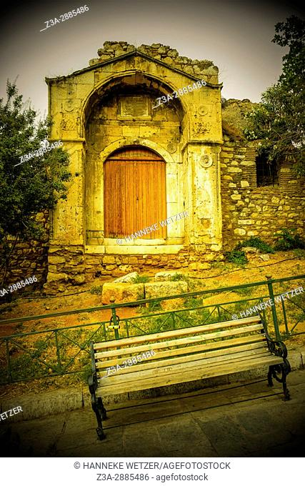 Wooden bench in front of a little chapel in Athens, Greece, Europe
