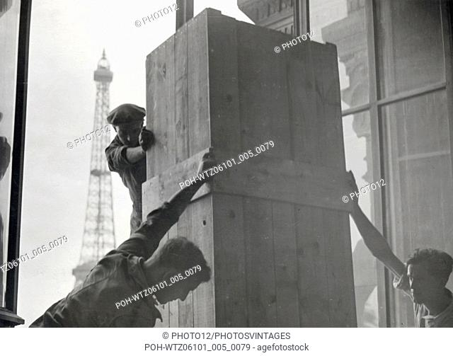 Statues and other breakable things of the Trocadero palace are being wrapped to be transported to another place Paris September 3, 1935